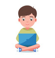 boy sits and plays on the laptop vector image vector image