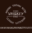 grunge vintage whiskey font old handcrafted vector image