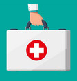 first aid kit in hand vector image vector image