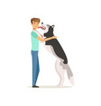happy dog licking man s face guy having fun with vector image vector image