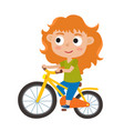 cartoon red-haired girl riding a bike having fun vector image