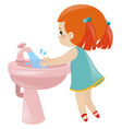 girl washing hands in sink vector image