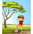 A boy with a soccer ball vector image vector image