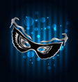 carnival ornate mask on blue glowing background - vector image vector image