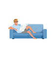 young man sitting on a blue sofa and reading vector image