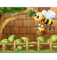 A bee holding a honey inside the fence vector image vector image