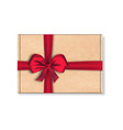 cardboard package box with big red ribbon bow vector image vector image