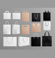realistic paper bags black white shopping bag vector image vector image