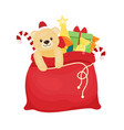 red christmas bag with presents santa s bag vector image