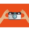 hand holds camera photo orange background design vector image