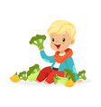 happy blonde little boy sitting on the floor vector image vector image