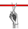 womans hand with scissors cutting red ribbon vector image vector image