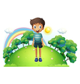 A boy standing in the middle of the hill vector image vector image