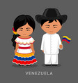 venezuelans in national dress with a flag vector image vector image