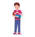 young father feeding a baby from a bottle vector image vector image