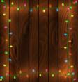 garland frame on wood background vector image vector image