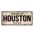 welcome to houston vintage rusty metal sign vector image vector image