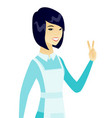 young asian cleaner showing victory gesture vector image vector image