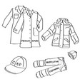 set of hand drawn workwear doodles isolated on a vector image
