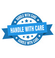 handle with care ribbon handle with care round vector image vector image