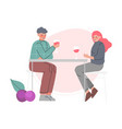 young man and woman sitting at table and drinking vector image