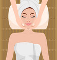 beautiful woman taking facial massage vector image