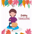 happy thanksgiving day young man sitting with cake vector image