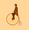 Riding a penny farthing