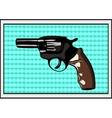 The pop art Gun on a polka-dot background vector image