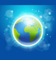 shining earth on blue bokeh background 22 april vector image