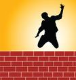 man jump brick wall silhouette vector image