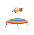 cute happy boy jumping on trampoline smiling vector image vector image