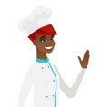 Young african-american chef waving her hand