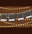 blank photo frames hanging on wooden board vector image