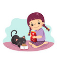 a little girl feeding her cat vector image vector image