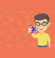 caucasian boy playing with fidget spinner vector image vector image