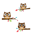 Family of owls sat on a tree branch vector image vector image