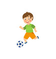 flat boy character playing football vector image vector image