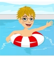 little boy swimming in pool with inflatable ring vector image