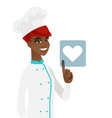 young african chef pressing web button with heart vector image vector image
