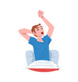 young man stretching on his bed after waking up vector image vector image
