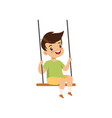 cute little boy swinging on a rope swing kid vector image vector image
