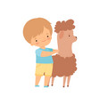 cute boy hugging llama kid interacting with vector image