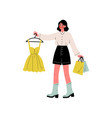 young beautiful woman carrying yellow dress on vector image