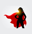 female superhero silhouette with cape in action vector image