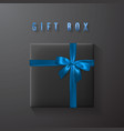 black gift box with blue bow and ribbon top view vector image vector image