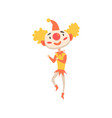 funny clown in a red hat dancing colorful cartoon vector image vector image