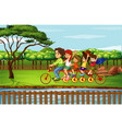 family riding bike in park vector image vector image