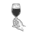 huge glass with wine in hand sketch vector image vector image