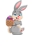 easter bunny carrying basket of easter egg vector image vector image
